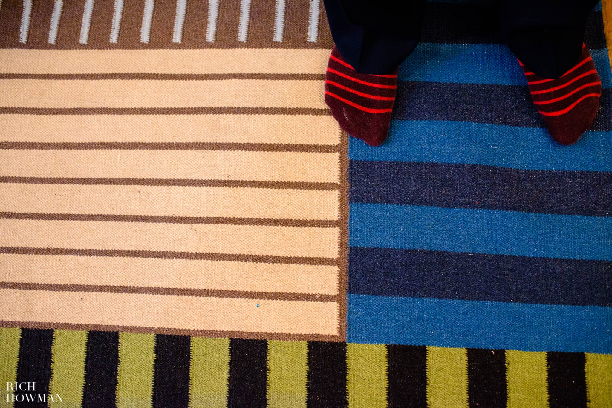 Striped socks on a striped rug