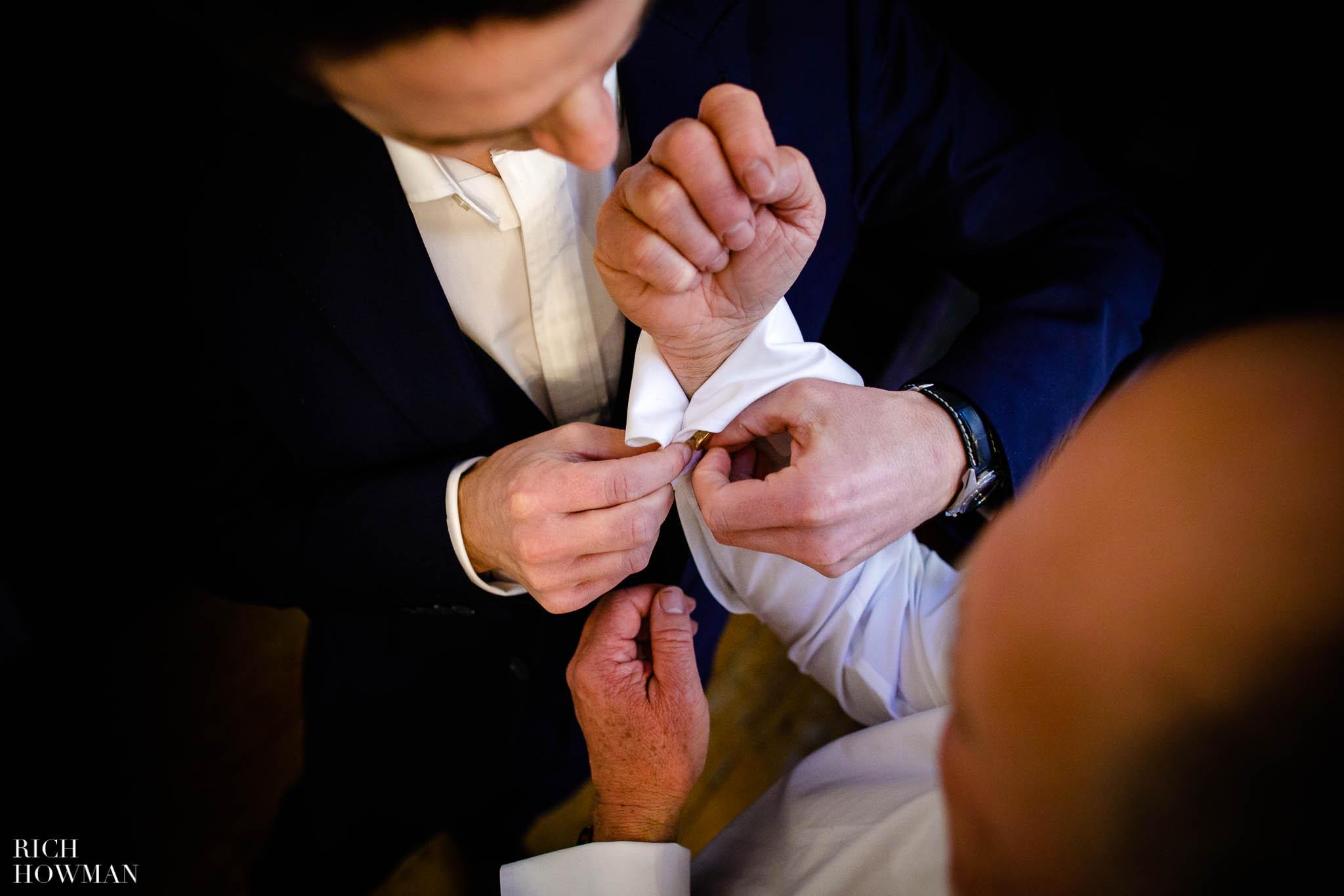 The boys doing up cufflinks prior to a wedding at Huntsham Court