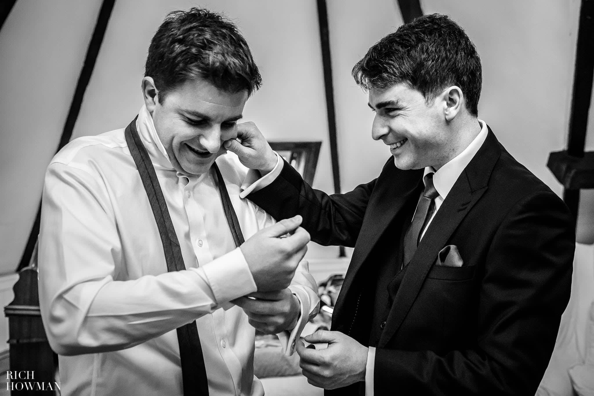 Brothers preparing for a Huntsham Court wedding with one teasing the other