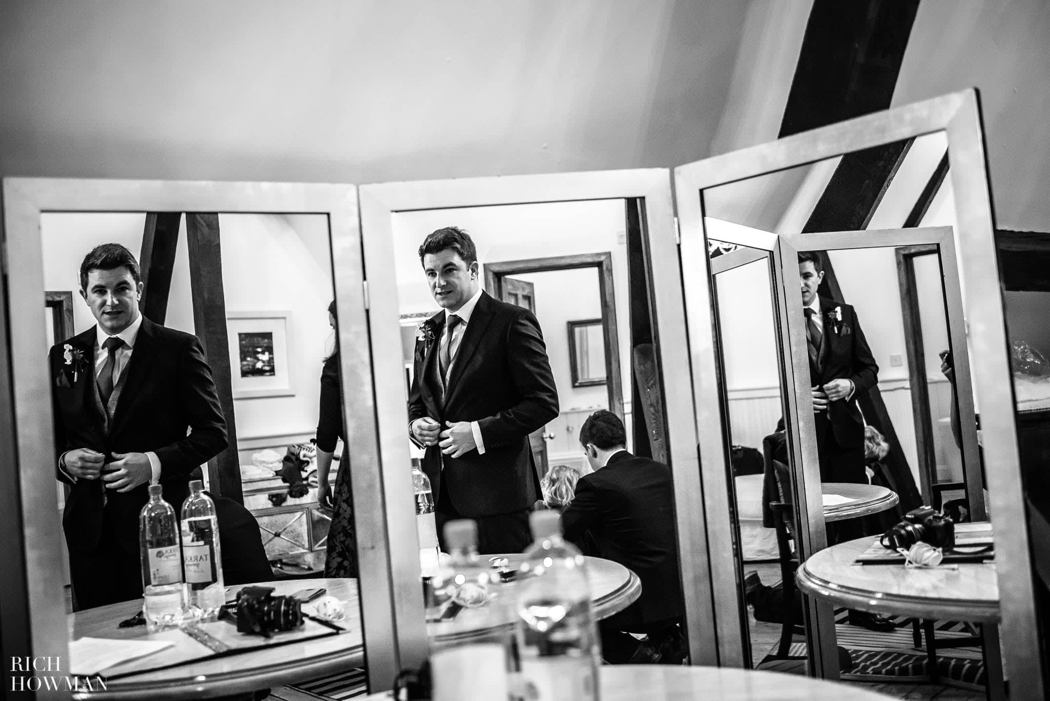 Groom photographed reflected in three mirrors