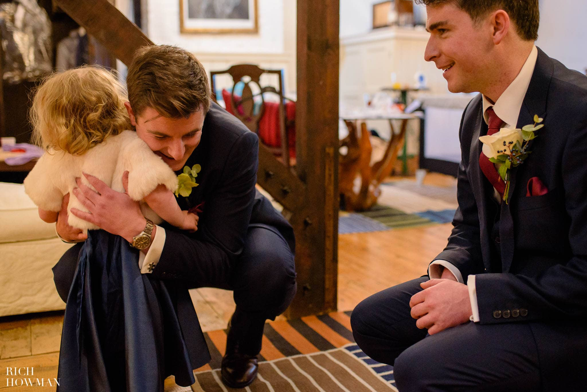 Groom hugging his niece before his wedding