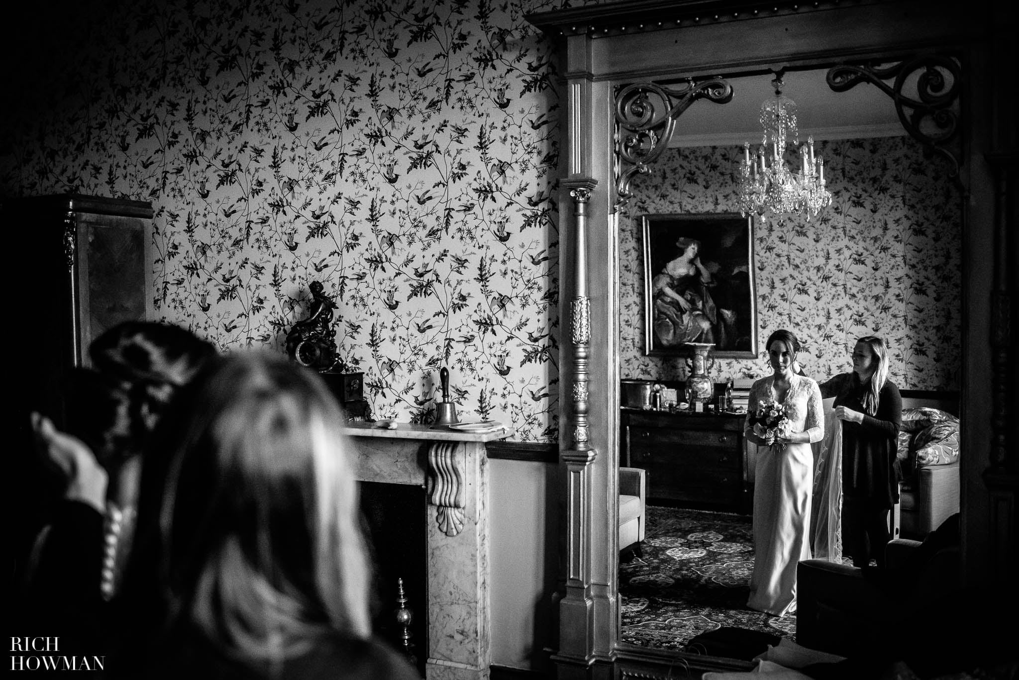 Wide angle of the bride in her wedding dress at Huntsham Court