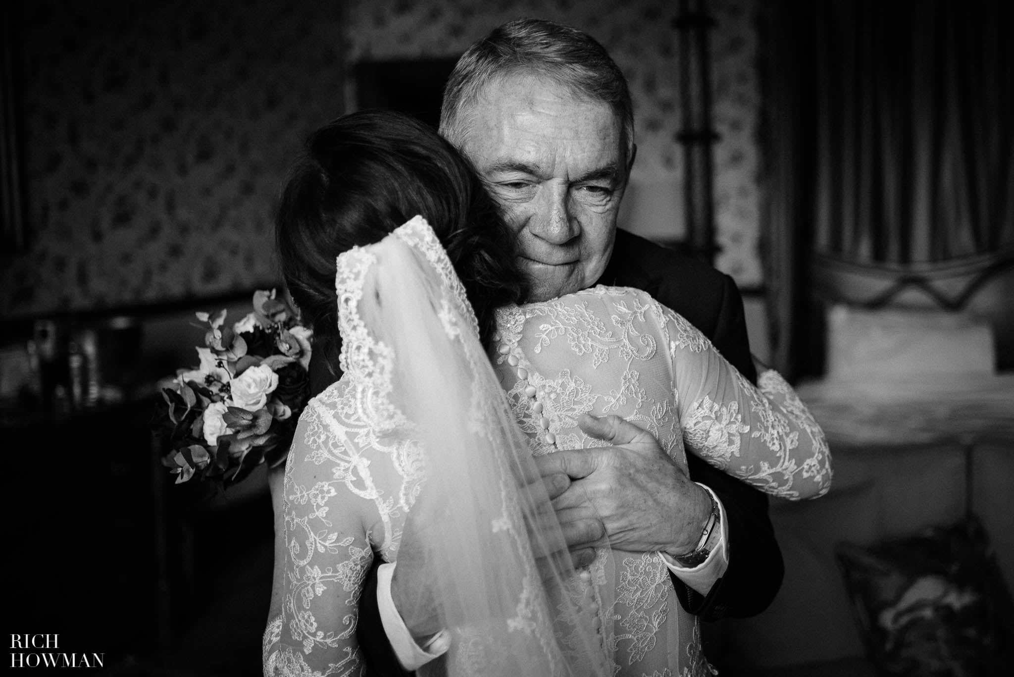Brides Father embraces his daughter on her wedding day at Huntsham Court