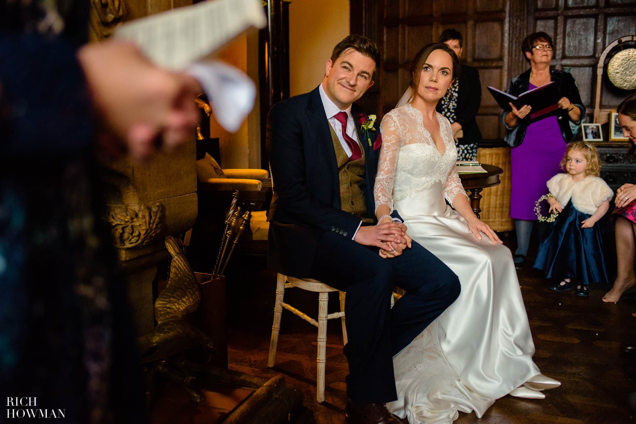Bride and groom enjoy a reading during their wedding photography at Huntsham Court