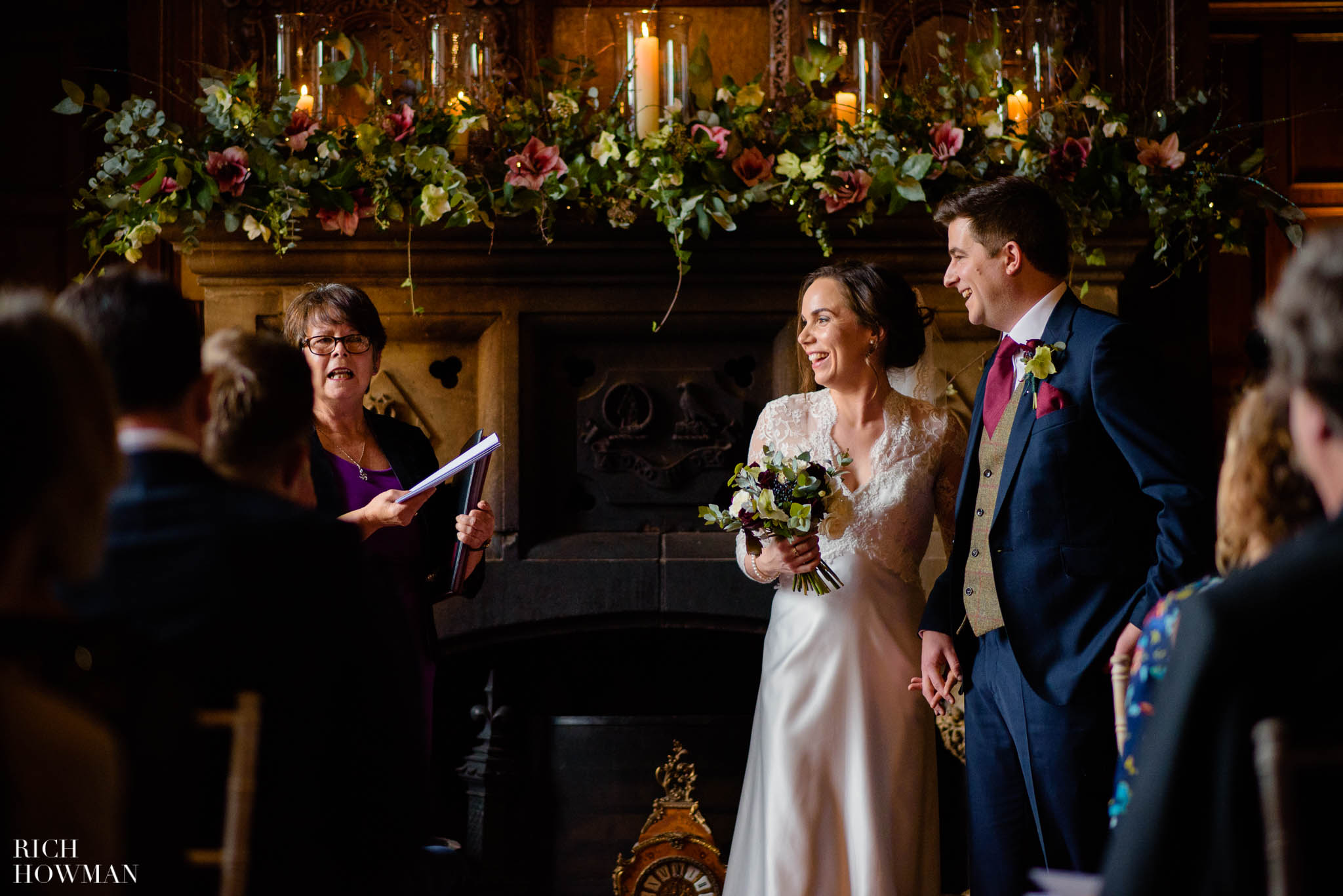 Registrar reads the vows during a wedding photo story at Huntsham Court in Devon