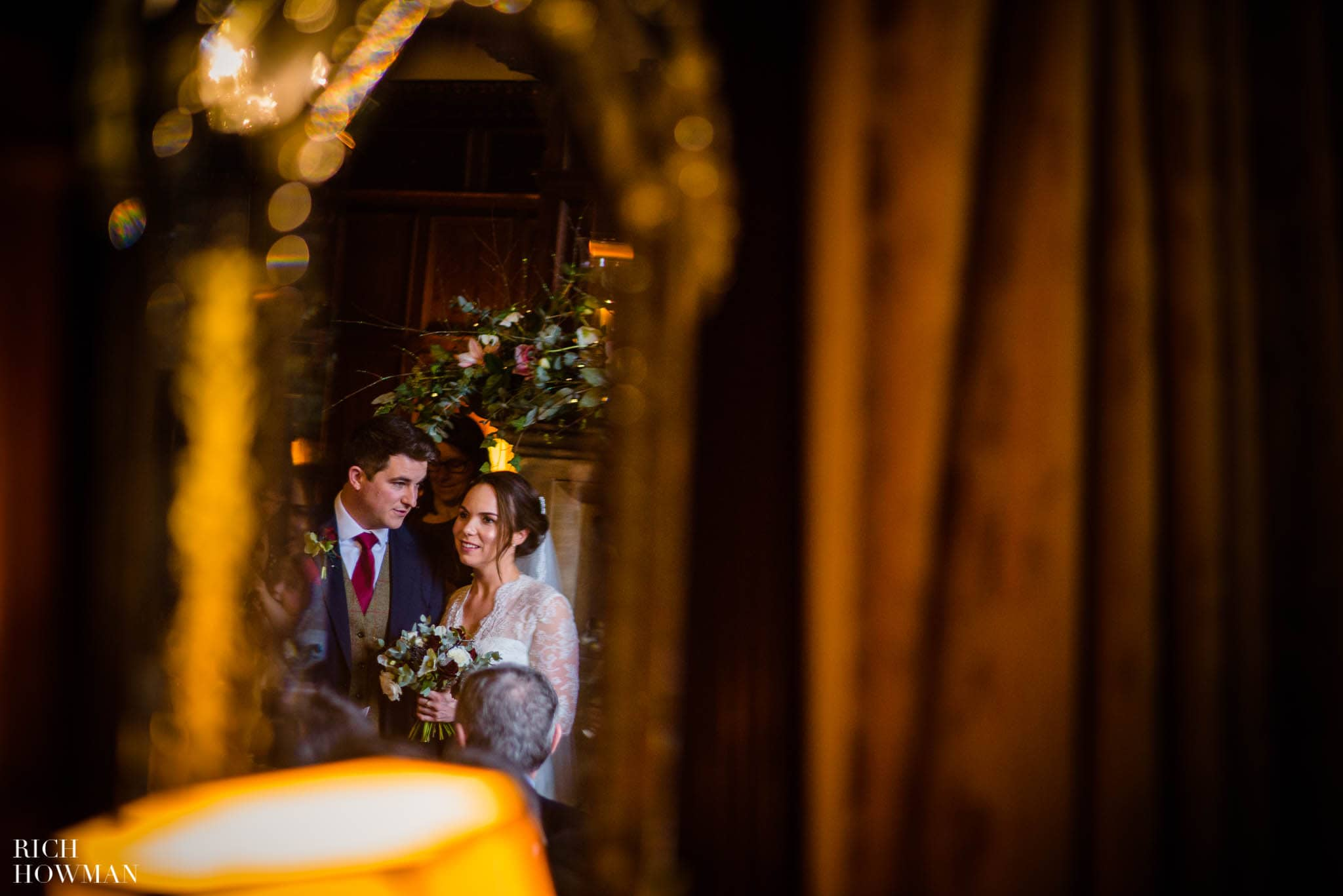 The happy couple reflected in a mirror on their Huntsham Court wedding day