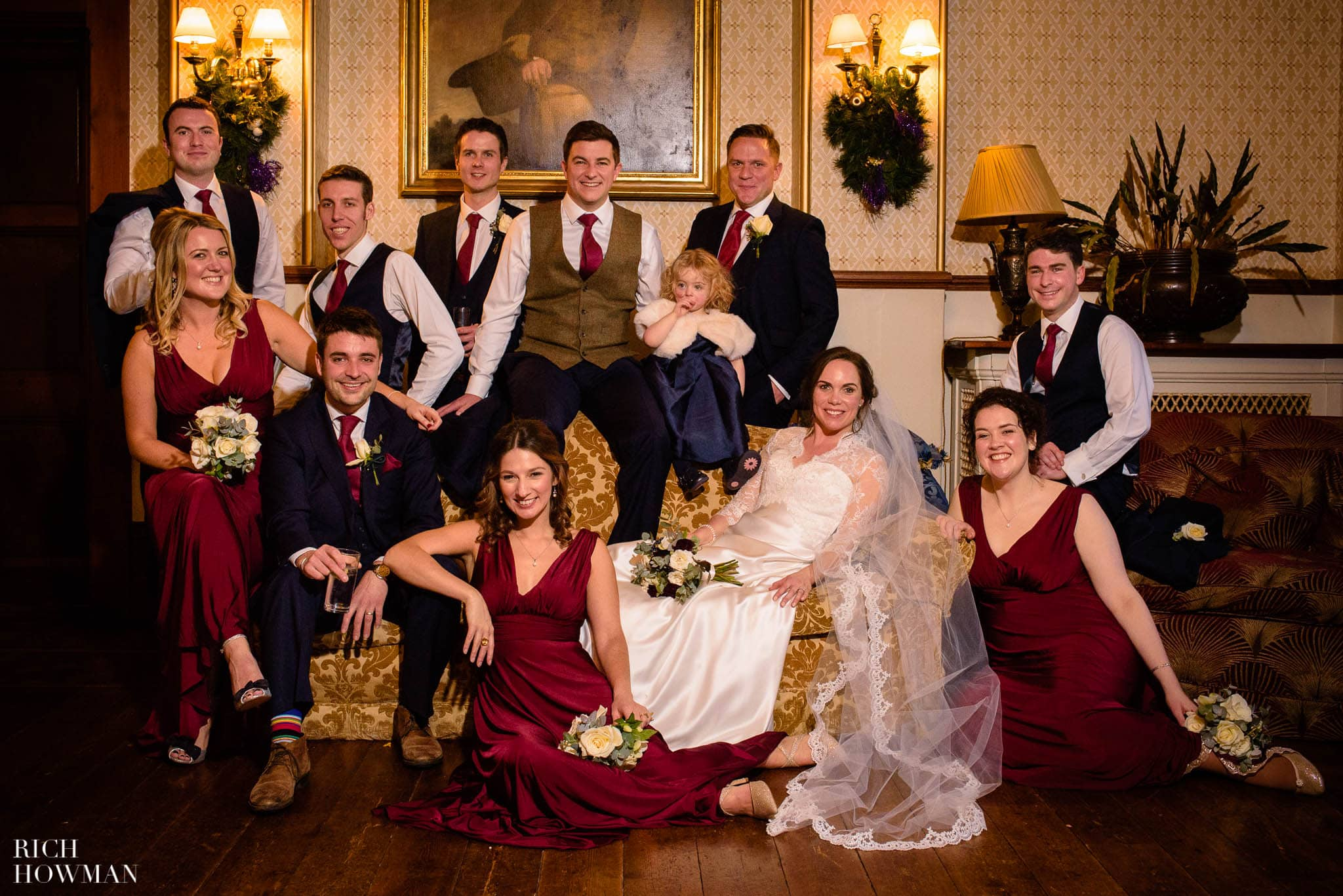 Traditional wedding photography group portrait at Huntsham Court